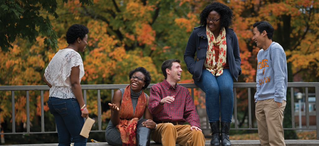 Students on patio conversing.
