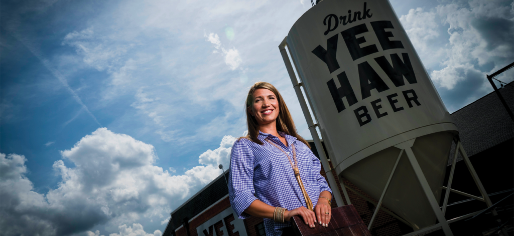 Jessi Edwards Baker ('03) outside the headquarters of Yee-Haw Brewing Company in Johnson City.