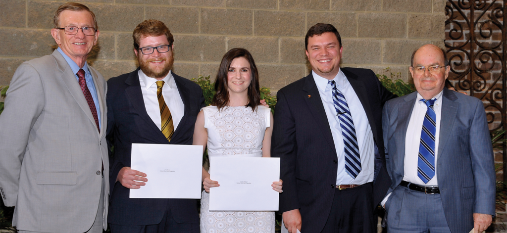 Professor and National Moot Court coach Joe Cook (far right) stands with (from left) co-coach and professor John Sobieski and 2014–2015 National Moot Court Team members John Baxter ('16), Kaitlyn Holland ('16), and Jarrod Casteel ('16). Under Cook and Sobieski's guidance, the 2014–2015 team competed in the National Moot Court finals and won the award for best brief.