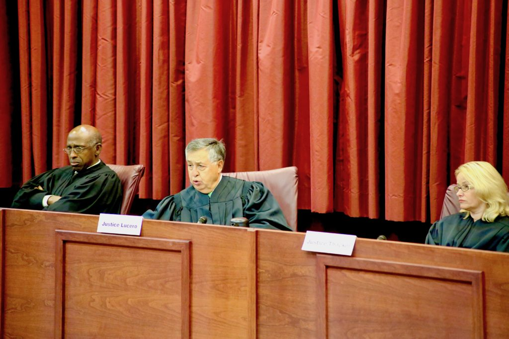 United States Court of Appeals judges Joseph A. Greenway, Jr., Carlos F. Lucero and Stephanie D. Thacker listen to students' arguments.